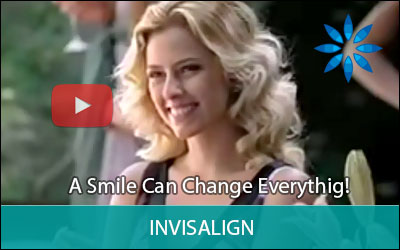 Image of a video about Invisalign treatment, displaying the button to be clicked for the video to play.